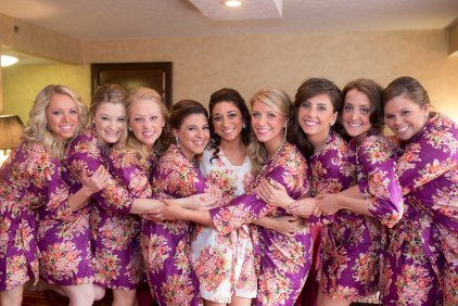 All my girls in their bridesmaid floral robes!