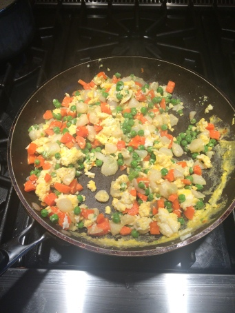 mixed vegetables with the egg, continue to cook